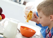 Young boy by the table — Stock Photo