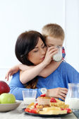 Mother with kid during family breakfast — Stock Photo