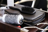 Curler and comb on nightstand — Stock Photo