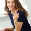 Curly woman showing middle finger — Stock Photo