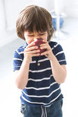 Adorable kid with apple — Stock Photo