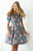 Curly woman in cute dress — Stock Photo