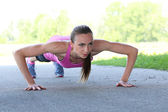 Woman during push-ups — Stock Photo
