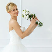 Attractive bride with smile — Stock Photo