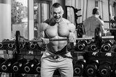 Powerful man during workout — Zdjęcie stockowe