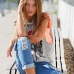 Beautiful girl in torn jeans — Stock Photo #48593971