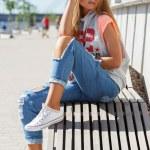 Beautiful girl in torn jeans — Stock Photo #48593977