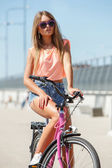 Attractive girl with bike — Stock Photo