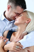 Couple embracing at home — Stock Photo