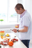 Attractive man at kitchen — Stock Photo