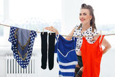 Pin up girl in pantyhose hanging laundry — Stock Photo