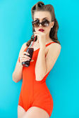 Pin up woman in red swimsuit — Stock Photo