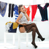 Pin up woman on heels with wet clothes — Stock Photo