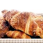 Постер, плакат: Delicious croissants in the basket