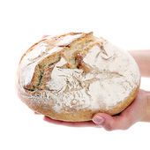 Man holding loaf of bread — Stock Photo