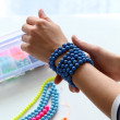 Woman with homemade blue bracelet — Stock Photo #49050795