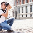 Tourist with camera during vacation trip — Stock Photo #49050973