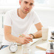 Man by the table at kitchen — Stock Photo #49051229
