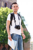 Tourist with map during vacation trip — Stock Photo