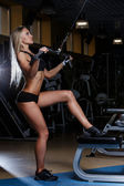 Attractive woman in gym — Stock Photo