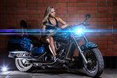 Sexy girl on the bike — Stock Photo