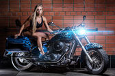 Sexy girl on the bike — Stock Photo