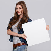 Woman with white billboard — Stock Photo