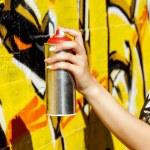 Girl holding spray can — Stock Photo #50394203