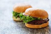 Tasty burgers on the table — Stockfoto
