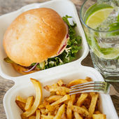 Tasty burger with fries on table — Stock Photo
