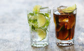 Drink with lime on table — Stock Photo