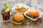 Tasty burgers on the table — Stock Photo