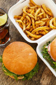 Tasty burgers on the table — Stock Photo