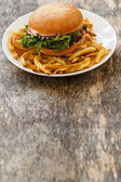 Tasty burger with fries — Stock Photo