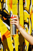 Girl holding spray can — Stock Photo