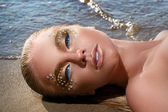 сексуальная девушка на пляже — Стоковое фото