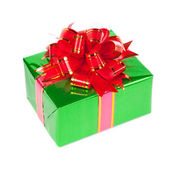 Gift in colorful package with bows — Stock Photo