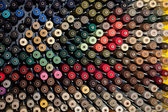 Reels with colorful threads — Stock Photo