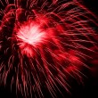 Red fireworks in the night sky — Stock Photo #19122207