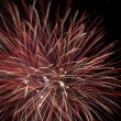 Red fireworks in the night sky — Stock Photo #21457239
