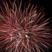 Red fireworks in the night sky — Stock Photo