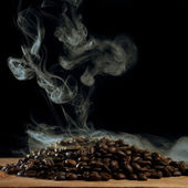 Roasted coffee with smoke — Stock Photo