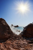 Rocks, sea and sun on a blue sky — Stock Photo