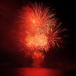 Red fireworks in the night sky — Stock Photo #32473759