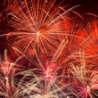 Red fireworks in the night sky — Stock Photo #32474149