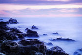 Seashore with misty water at sunset — ストック写真