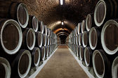 Warehoused barrels in the wine cellar — Stock Photo