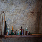 Old pharmacist's bottles on the shelf — Stock Photo