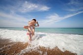 Mother and son play in  waves — Stock Photo