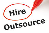 Hire or Outsource with Red Marker — Stock Photo